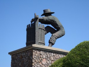 Grapecrusher, a bronze statue by Gino Miles